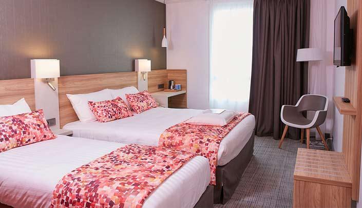 Chambre familiale de l'hôtel Kyriad Pontarlier